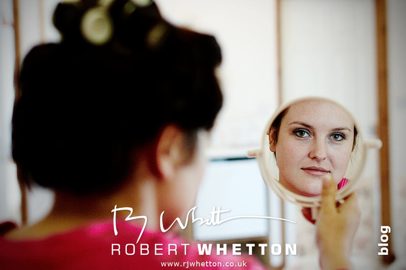 Jo looking in mirror - Dorset Wedding Photographer Robert Whetton