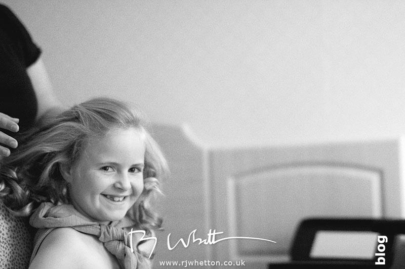 Bridesmaid having her hair done - Professional Wedding Photography Dorset