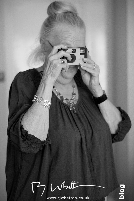 Rebecca's mum can't resist photographs with her disposable - Professional Wedding Photography Dorset