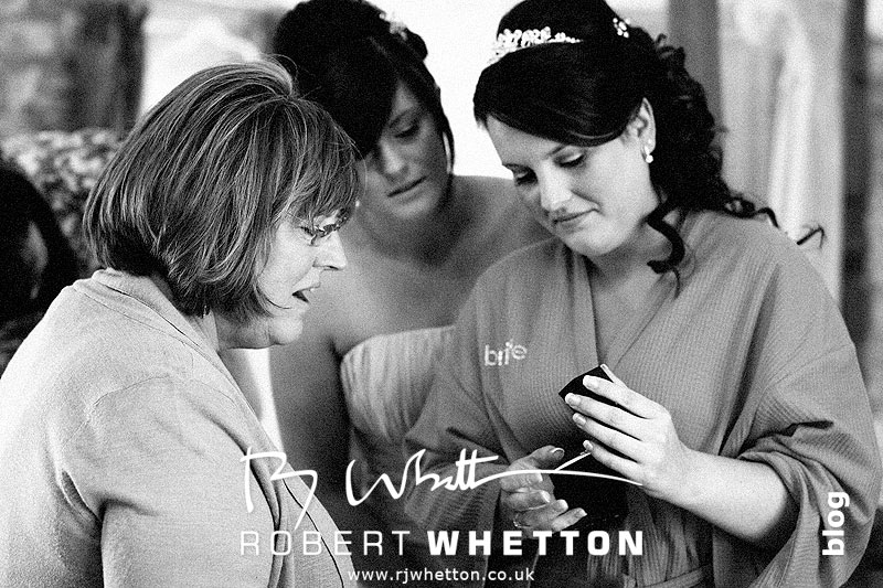 Jo with her mum and sister, presents - Dorset Wedding Photographer Robert Whetton