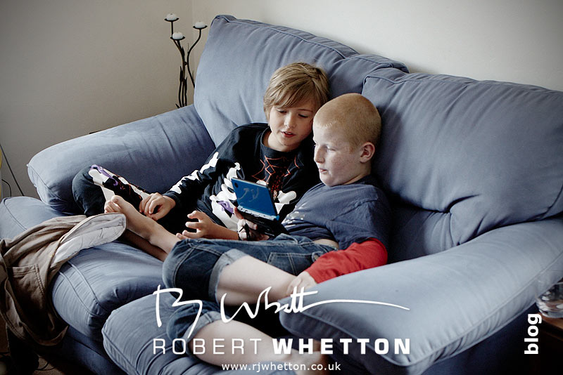 Boys playing on Nintendo DS - Dorset Wedding Photographer Robert Whetton