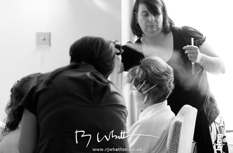 Rebecca spends some time having her hair done - Professional Wedding Photography Dorset