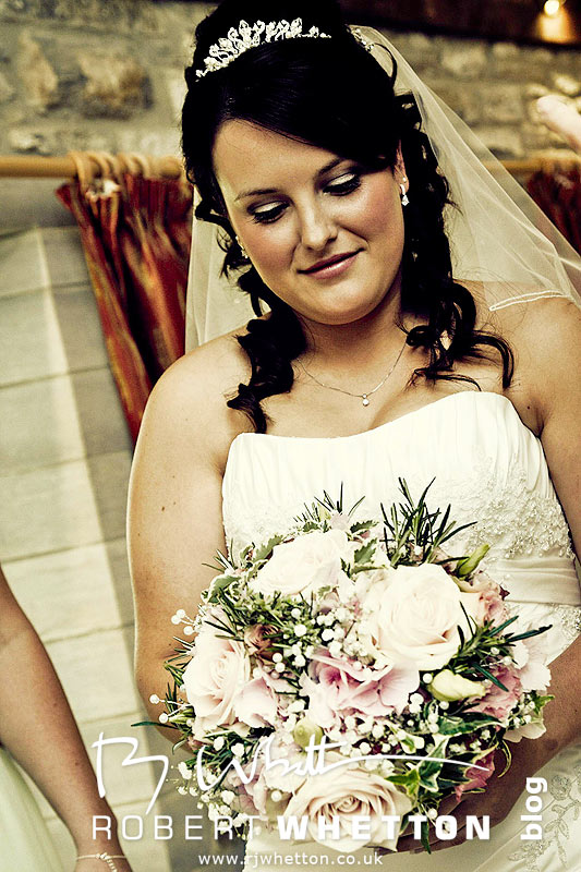 Jo admiring her bouquette - Dorset Wedding Photographer Robert Whetton