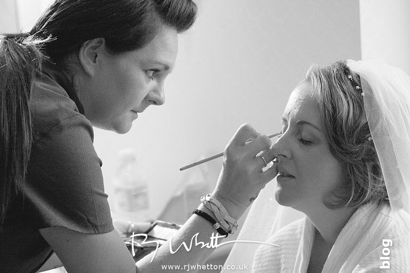 Some extra touches to Rebecca's make up - Professional Wedding Photography Dorset