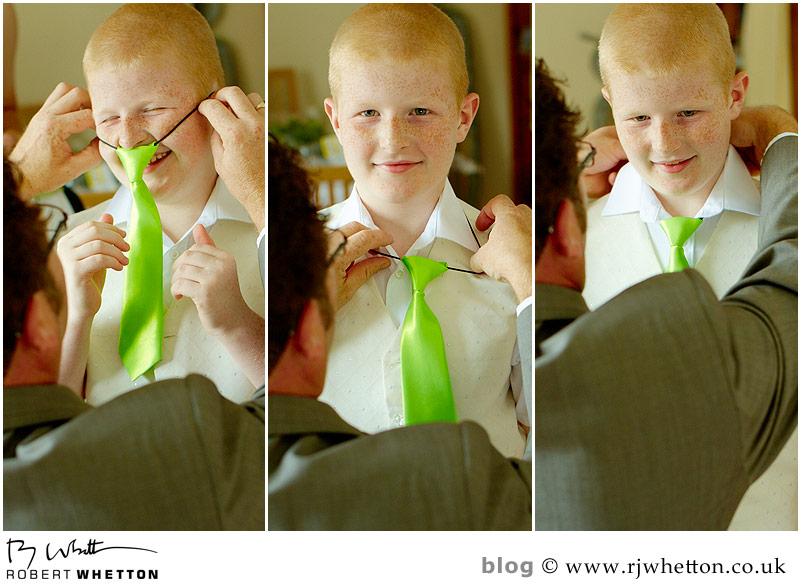 putting on tie - Dorset Wedding Photographer Robert Whetton