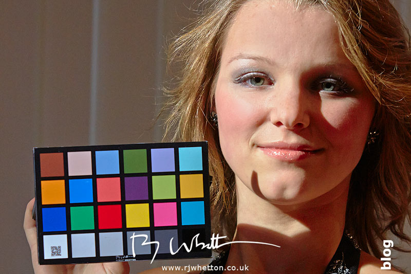 Millie Taylor holding colour chart