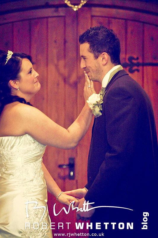 Jo wipes off her lipstick - Dorset Wedding Photographer Robert Whetton