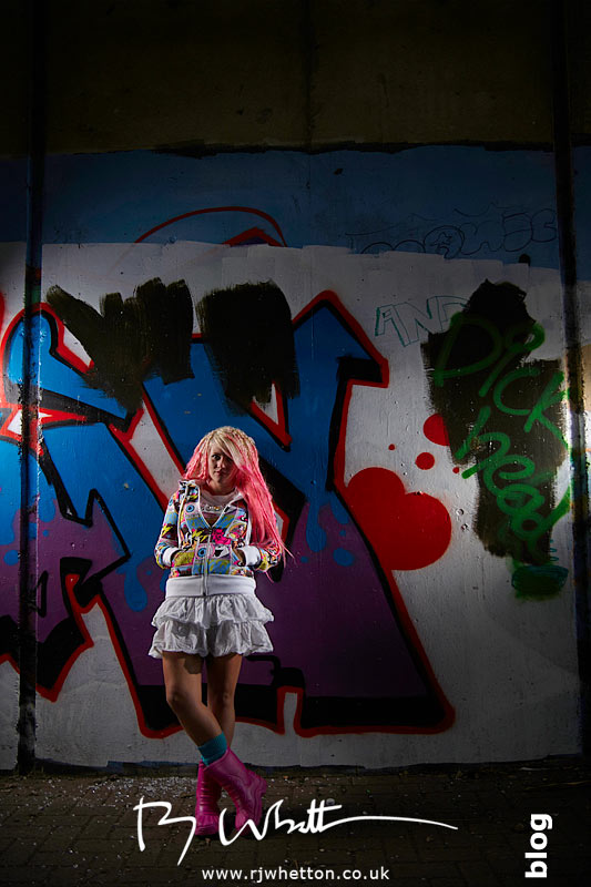 Wide angle of Pixie against a graffiti'd wall - Professional Portraits Dorset