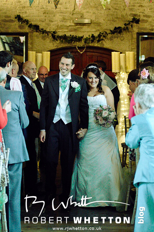 Mr and Mrs Christie walk down the isle - Dorset Wedding Photographer Robert Whetton