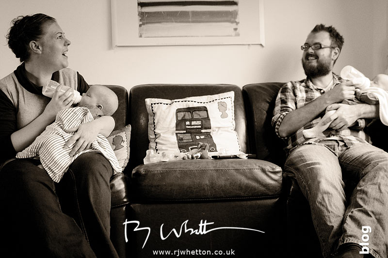 Mum and Dad bottle feed the twins -   Baby Portraits - Professional Portraits Dorset