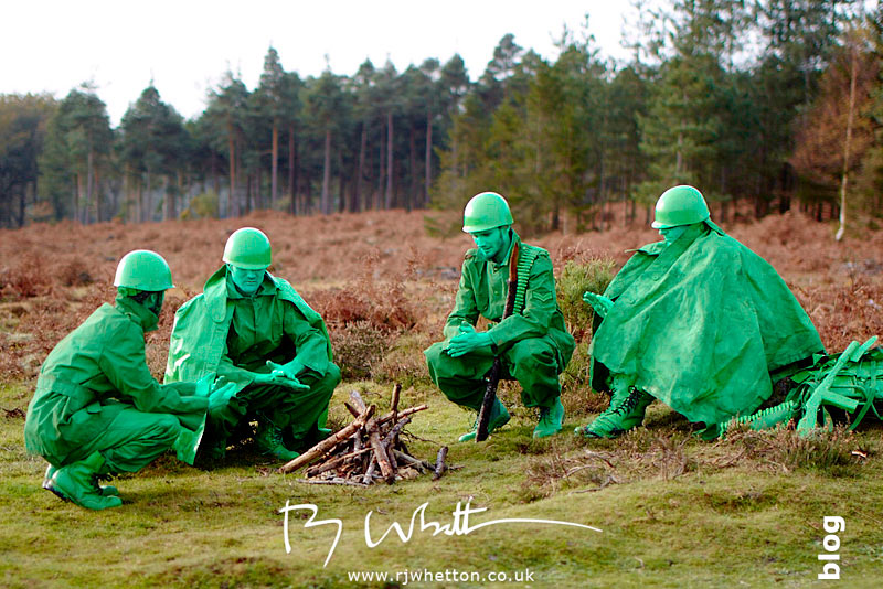Green army men huddled around camp fire - Production Photography Dorset