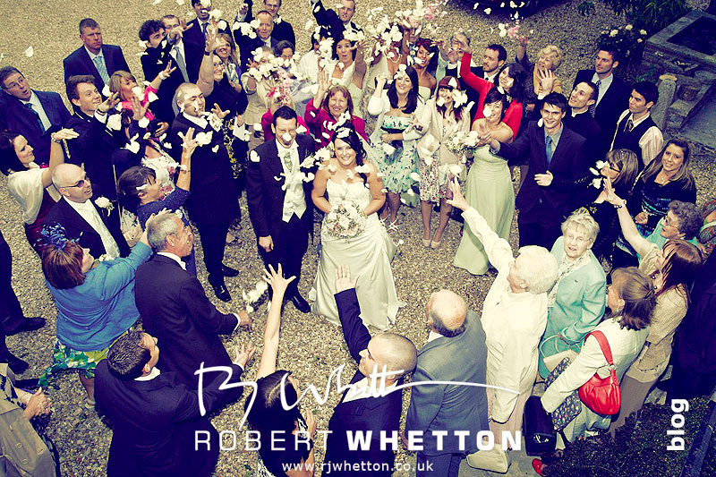 Throwing the confetti - Dorset Wedding Photographer Robert Whetton