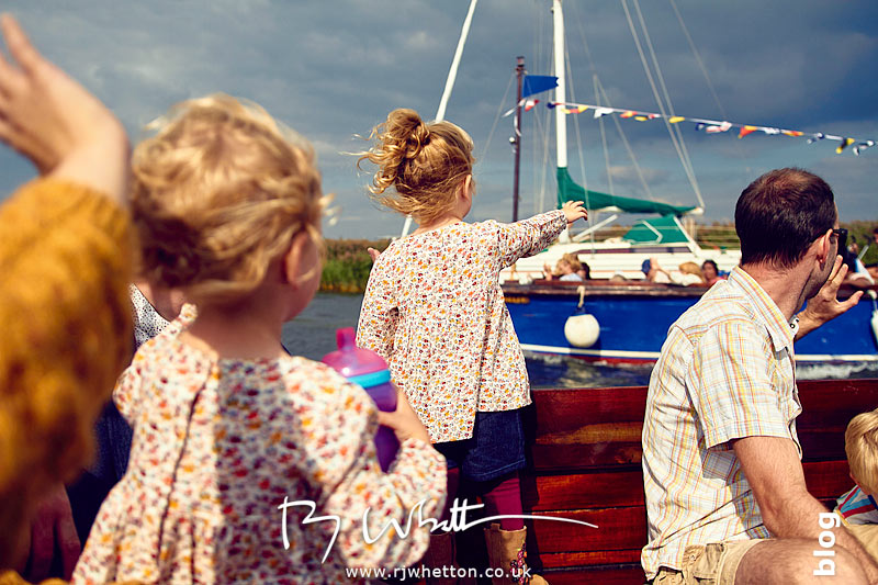 Everyone waving at boat - Portrait Photography Dorset