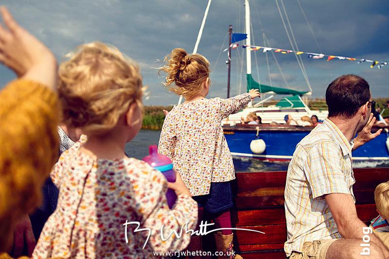 Everyone waving at boat - Portrait Photography Dorset