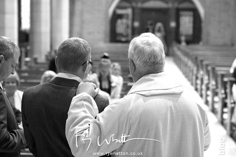 Father Denis reassuring Darren - Professional Wedding Photography Dorset