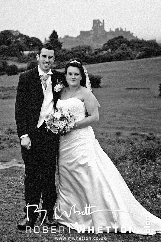 Jo and Ben on a hill overlooking Corfe Castle - Dorset Wedding Photographer Robert Whetton