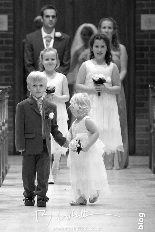 Wedding precession walks down the isle - Professional Wedding Photography Dorset