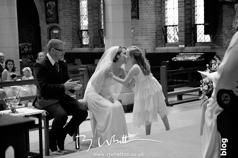 Rebecca gives a kiss for a wonderful speech - Professional Wedding Photography Dorset