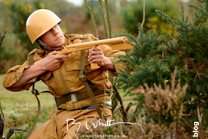Orange army man shooting at green army - Production Photography Dorset