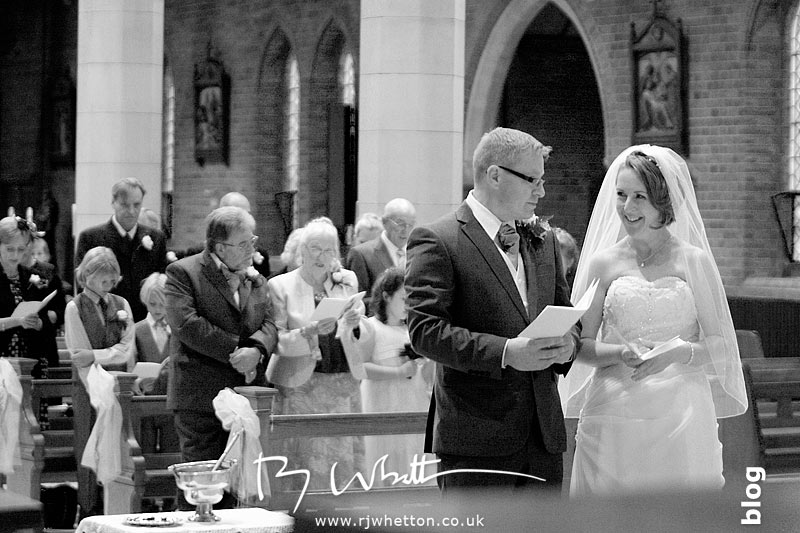 Darren and Rebecca exchange a glance during the service - Professional Wedding Photography Dorset