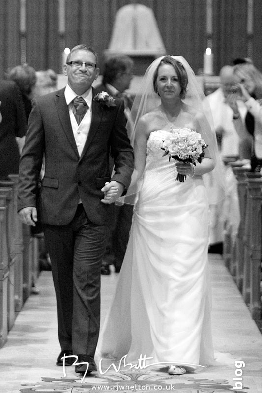 Happy couple exit the church - Professional Wedding Photography Dorset