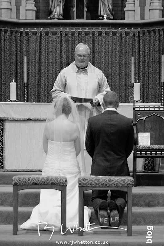 Father Denis blessing the couple - Professional Wedding Photography Dorset