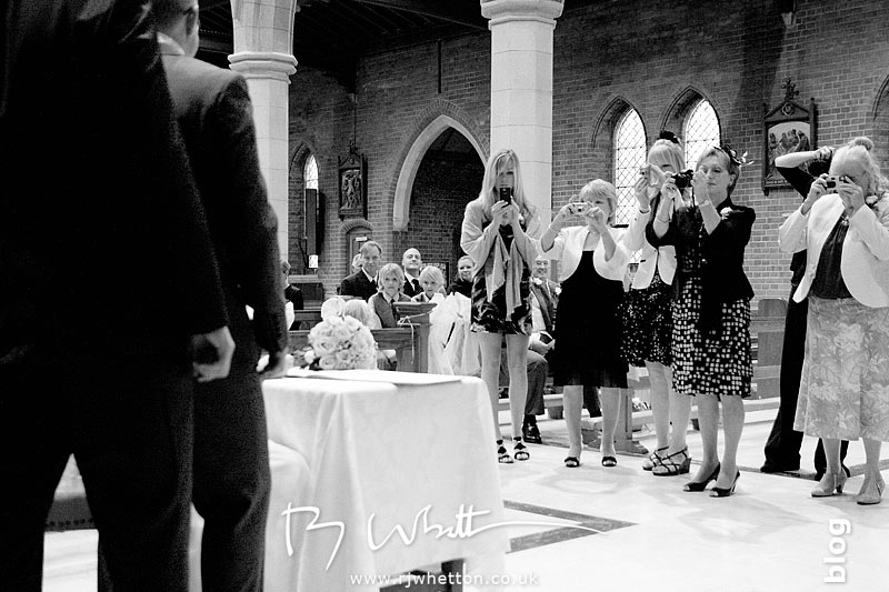 As always the wedding paparazzi are eager to take their photographs - Professional Wedding Photography Dorset