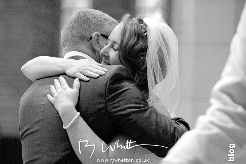 Embrace after the giving of the rings - Professional Wedding Photography Dorset