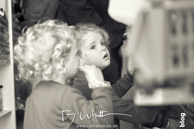 The girls wait patently for their ice creams - Portrait Photography Dorset