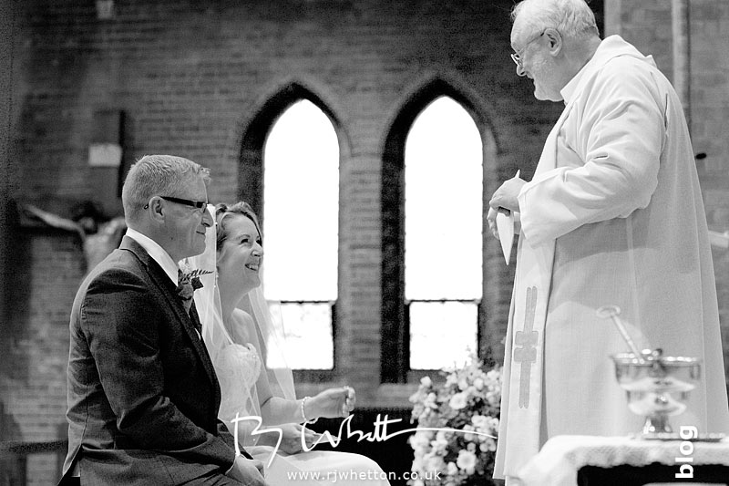 Father Denis says a funny - Professional Wedding Photography Dorset