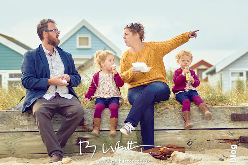 Family sit to eat their treats - Portrait Photography Dorset