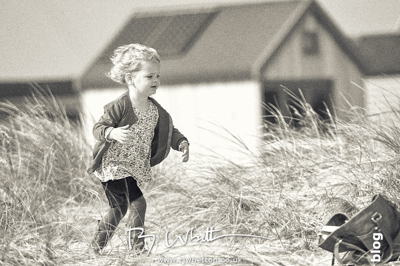 Harper running on Hegistbury Head - Portrait Photography Dorset