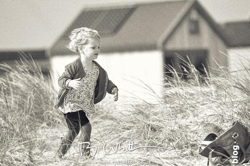Harper running on Hegistbury Head - Portrait Photography Dorset