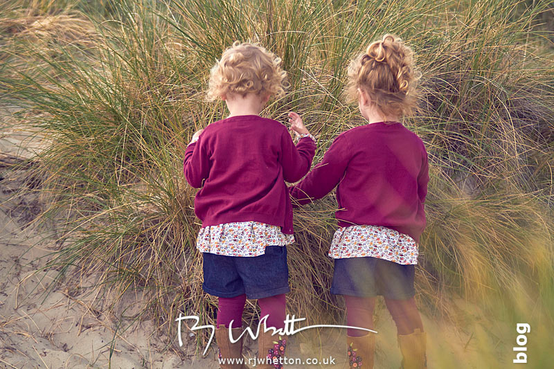 Harper and Scout hiding while playing hide and seek with mum- Portrait Photography Dorset