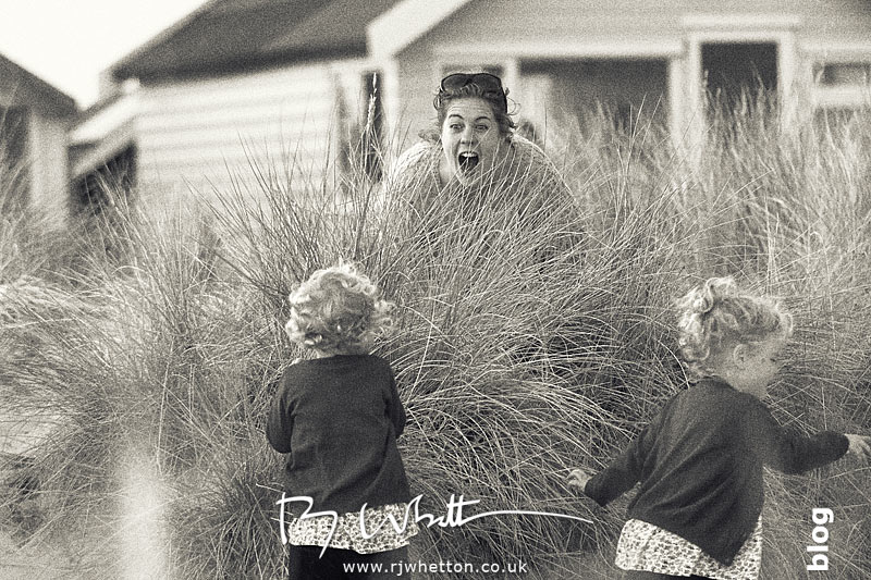 Lou finds Harper and Scout when playing hide and seek - Portrait Photography Dorset