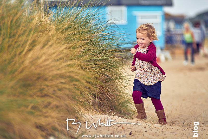 Harper running while playing hide and seek - Portrait Photography Dorset