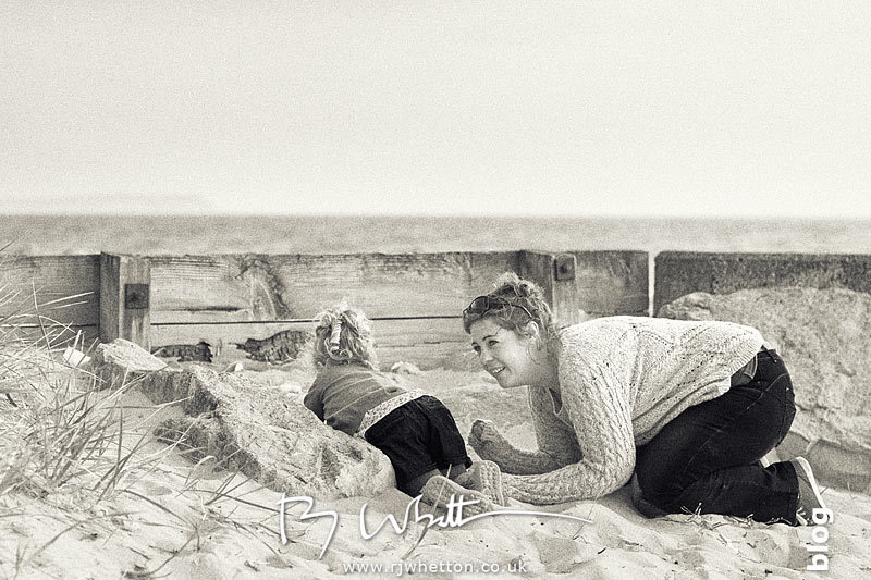 Scout and mum hide during hide and seek - Portrait Photography Dorset