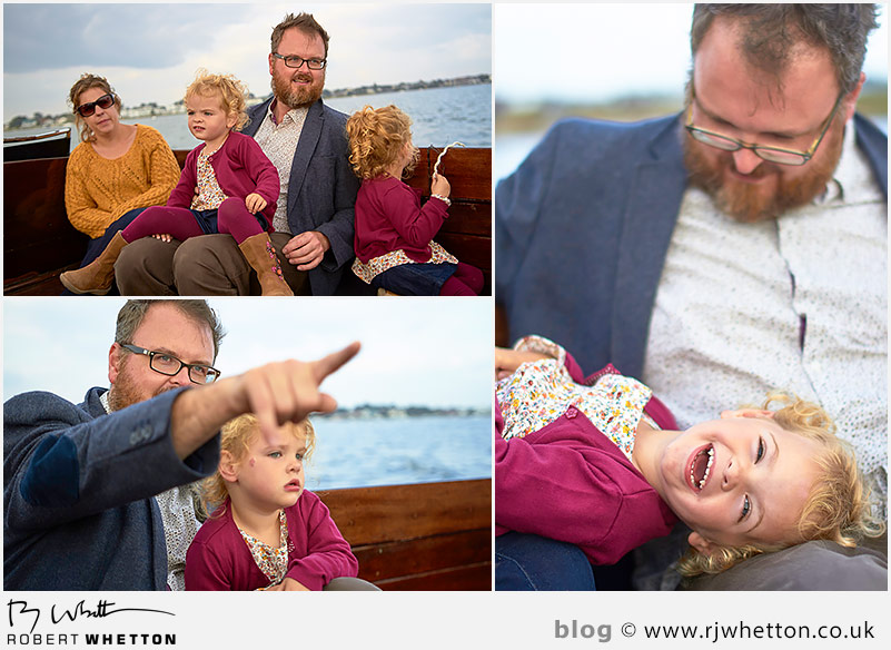 Harper being tickled by dad on the boat - Portrait Photography Dorset