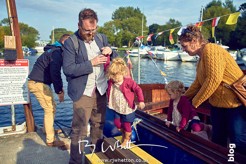 Everyone disembarks the boat to dry land once more - Portrait Photography Dorset
