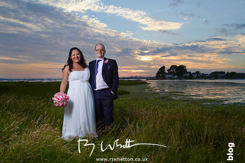 Claudia and Adam pose in the sunset over Poole bay, Sandbanks - Wedding Photography Dorset
